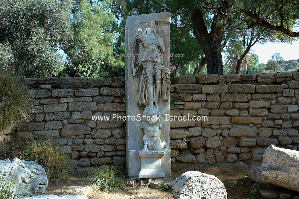 Statue of Nike, Roman victory goddess, on top of Atlas, Ashkelon National park, Israel<br /> Ashkelon is built upon the ruins of past civilizations. This was one of five Philistine city-states. The city also plays a role in biblical history as the place where Delilah cut Samson's hair to sap his strength. Ashkelon was also a great trading center because it lay along the Via Maris, the route linking Egypt with Syria and Mesopotamia. The city became a Christian city in the Byzantine period and was captured by the Muslims in 638 C.E. The Crusaders came next in 1153, but were defeated by Saladin. Richard the Lion Heart led the Crusaders back, but they were eventually driven out in 1280 by Sultan Baybars. The city was then abandoned until 1948 when the Jews of the new State of Israel began to rebuild it.