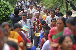 August 17, 2017 - Kathmandu, NP, Nepal - Devotees rotating Bagh Bhairab Temple along with the idol Bagh Bhairab on the occasion of the Bagh Bhairab festival celebrated at Kirtipur, Kathmandu, Nepal on Thursday, August 17, 2017. On the occasion of Bagh Bhairab festival, devotees used to round Bagh Bhairab Temple for 108 times for blessings with success and good health. (Credit Image: © Narayan Maharjan/Pacific Press via ZUMA Wire)