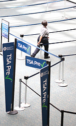 An airport employee wolks near the TSA Pre screening area as Orlando International Airport is closed on Tuesday, September 3, 2019 ahead of Hurricane Dorian. Photo by Stephen M. Dowell/Orlando Sentinel/TNS/ABACAPRESS.COM