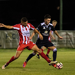 BRISBANE, AUSTRALIA - APRIL 7: Ramone Close of Olympic FC and Samuel Sibatuara of Brisbane City compete for the ball during the NPL Queensland Senior Men's Round 7 match between Olympic FC and Brisbane City at Goodwin Park on April 7, 2017 in Brisbane, Australia. (Photo by Patrick Kearney/Olympic FC)