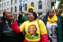 April 27, 2019 - London, UK, United Kingdom - Supporters of the African National Congress party are seen singing and dancing outside High Commission of South Africa in London during the general election..Over 9000 South Africans have registered to vote in the UK, which is the highest number of registered voters living abroad. The Electoral Commission has extended voting hours for South African citizens in London until 11:30 pm on Saturday night because of the Vaisakhi Festival at Trafalgar Square. (Credit Image: © Dinendra Haria/SOPA Images via ZUMA Wire)
