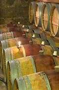 Oak barrel aging and fermentation cellar. Candle for lighting the sulphur pellet inside the barrel. Chateau Brane Cantenac, Margaux, Medoc, bordeaux, France