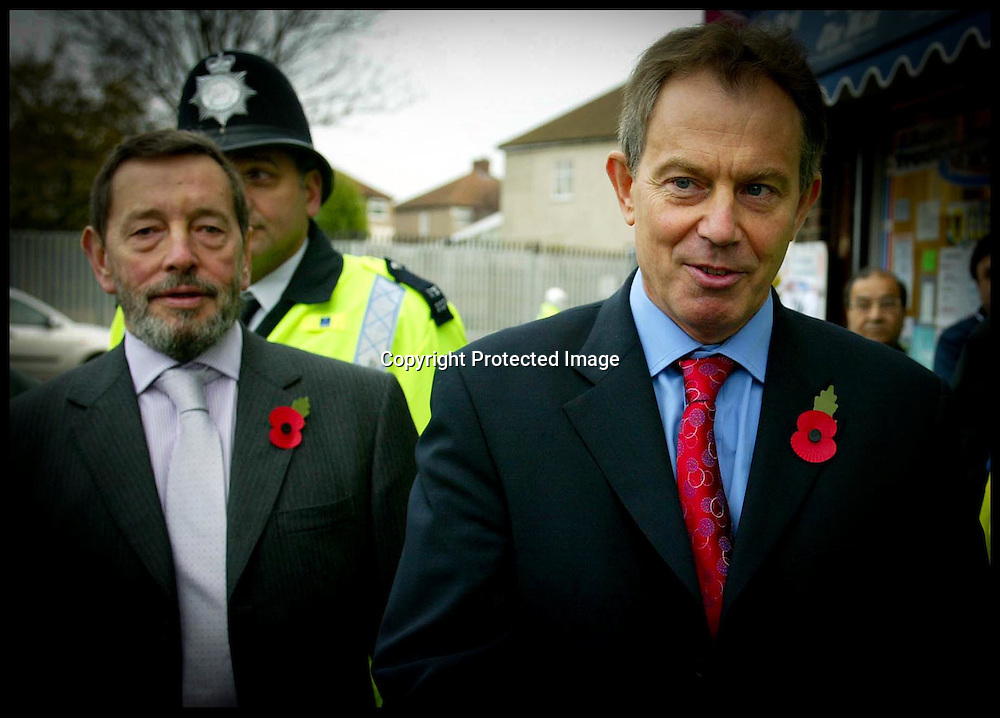 The British Prime Minister Tony Blair and David Blunkett walk the streets of Falonwood Nr Welling, with Police Constable  Support Oficer Tracey Bush,Today Tuesday 9th November 2004 on the day the Government annouce A Police reform policy Paper  .PA Photo Andrew Parsons