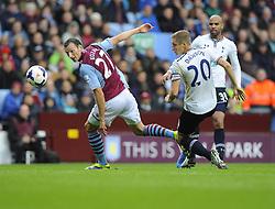 Aston Villa's Libor Kozak  battles for the high ball with Tottenham Hotspur's Michael Dawson - Photo mandatory by-line: Joe Meredith/JMP - Tel: Mobile: 07966 386802 20/10/2013 - SPORT - FOOTBALL - Villa Park - Birmingham - Aston Villa v Tottenham Hotspur - Barclays Premier League