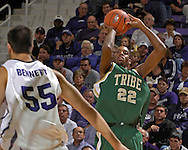William & Mary forward Danny Sumner (22) puts up a shot over Kansas State center Jaosn Bennett (55) in the first half at Bramlage Coliseum in Manhattan, Kansas, November 11, 2006.  K-State defeated the Tribe 70-60.<br />