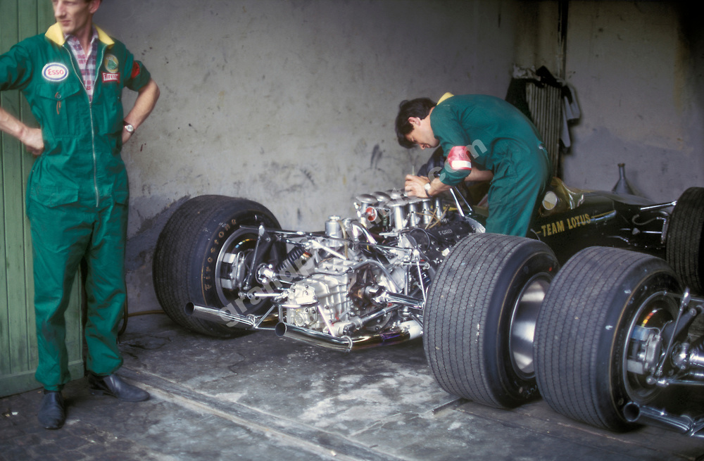 Lotus mechanics with the cars of Jim Clark and Graham Hill in the pits at Monza before the 1967 Italian Grand Prix. Photo: Grand Prix Photo