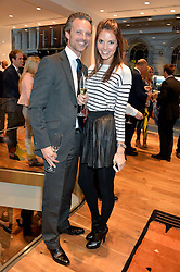 CARL WAXBERG and STEPHANIE PEERS at a party to celebrate the 30th Anniversary of the Breitling Chronomat held at 130 Breitling, New Bond Street, London on 7th May 2014.
