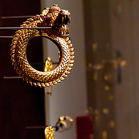 A golden dragon bracelet is displayed in theSoutheast Gold Museum that presents hundreds of golden artifacts from the private collection of founder Istvan Zelnik in Budapest, Hungary on September 15, 2011. ATTILA VOLGYI