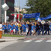 Start campagne Wij gaan weer naar School optocht door Huizen met politiemuziekkorps Gooi & Vechtstreek