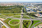 Nederland, Noord-Holland, Amsterdam, 27-09-2015; knooppunt Amstel, A2 en Ring A10. Rechts Overamstel en Amstel Business Park, industrie- en bedrijventerrein, links volkstuincomplex Amstelglorie.<br /> Amstel juction, entrance to Amsterdam.<br /> luchtfoto (toeslag op standard tarieven);<br /> aerial photo (additional fee required);<br /> copyright foto/photo Siebe Swart