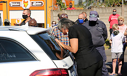 SOUTH AFRICA - Durban - 03 August 2020 - Despite strict protocols for funerals during the Covid-19 pandemic, which limits the number of mourners, the community of Queensburgh and Malvern found a way to bid farewell to one of their own who died last week.<br /> Malvern SAPS crime prevention unit member, W/O Anton Laas, who died in hospital last week, was well known in the community he loved and served.<br /> Picture: Motshwari Mofokeng/African News Agency (ANA)