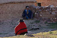 MUJER CON PONCHO Y COPLA DESCANSANDO Y HOMBRE BORRACHO EN LOS FESTEJOS DEL CARNAVAL, JUIRI, QUEBRADA DE HUMAHUACA, PROV. DE JUJUY, ARGENTINA