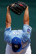 Kansas City Royals pitcher Bruce Chen stretches in the first inning of a baseball game against the Cleveland Indians at Kauffman Stadium in Kansas City, Mo., Sunday, July 27, 2014.  (AP Photo/Colin E. Braley)