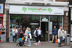 © London News Pictures. 14/07/2013. COPY AVAILABLE BELOW…. Hospice of Hope charity shop on Orpington High Street, Kent. Orpington High street now has 12 charity shops  in one short stretch, with Cancer Research UK having two shops on different sides of the high street almost facing each other.  COPY AVAILABLE HERE:  http://tinyurl.com/nhtxtyd<br /> <br /> Photo credit :Grant Falvey/LNP