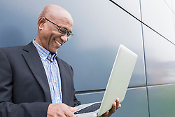 African businessman working using laptop computer
