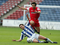 Photo: Paul Thomas.<br /> Huddersfield Town v Swindon Town. Coca Cola League 1. 29/10/2005. <br /> <br /> David Stoud of Swindon beats a tackle from Mark Hudson.