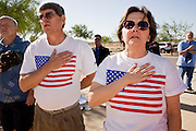 28 MAY 2007 -- PHOENIX, AZ: CLAY ARNOLD and his wife, LINDA ARNOLD, sing the Star Spangled Banner during the Memorial Day ceremony at the National Memorial Cemetery in Phoenix, AZ, Monday. There are more than 46,000 people buried in the National Memorial Cemetery in Phoenix.  Photo by Jack Kurtz/ZUMA Press