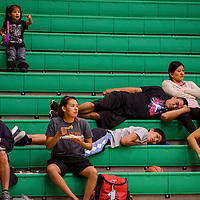 Players and spectators rest and watch from the stands during the 5th annual Don't Drink and Drive Peshlakai Angels basketball tournament in Newcomb Saturday.