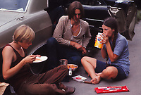 young people relaxing and eating on their way to the Woodstock music festival, 1969
