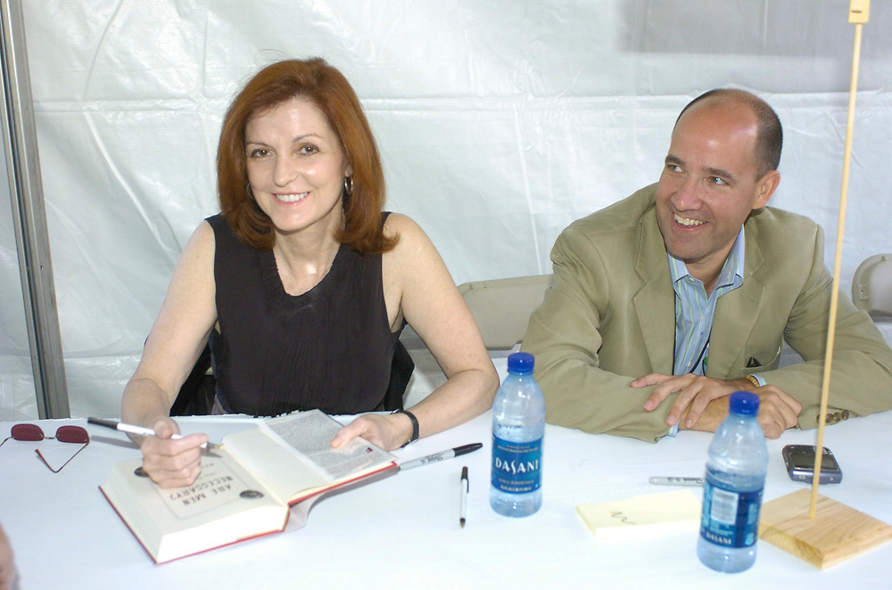 Austin, TX October 28, 2006: New York Times writer Maureen Dowd (l) and Republican strategist Matthew Dowd(no relation) sign book at the 11th annual Texas Book Festival at the State Capitol.  ©© Bob Daemmrich