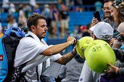 August 15, 2018 - Cincinnati, OH, U.S. - CINCINNATI, OH - AUGUST 15: Stan Wawrinka (SUI) signs autographs for fans after winning his match against Kei Nishikori (not pictured) during the Western & Southern Open at the Lindner Family Tennis Center in Mason, Ohio on August 15, 2018. (Photo by Adam Lacy/Icon Sportswire) (Credit Image: © Adam Lacy/Icon SMI via ZUMA Press)