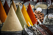 """SHOT 11/3/09 7:57:57 AM - Various spices for sale in one of the spice markets in the Mellah in Marrakech or Marrakesh, Morocco. The cones are actually paper, coated with glue and dusted with individual ground spices such as paprika and cumin. Marrakech is known as the """"Red City"""", is an important and former imperial city in Morocco. It has a population of 1,070,838 (as of 2004), and is the capital of the mid-southwestern economic region of Marrakech-Tensift-Al Haouz, near the foothills of the snow-capped Atlas Mountains. Like many North African and Middle Eastern cities, Marrakech comprises both an old fortified city (the médina) and an adjacent modern city (called Gueliz). Marrakech has the largest traditional market (souk) in Morocco and also has one of the busiest squares in Africa and the world, Djemaa el Fna. The square bustles with acrobats, story-tellers, water sellers, dancers, and musicians. By night, the square turns into food stalls, becoming a huge open-air restaurant. Morocco, officially the Kingdom of Morocco is a country located in North Africa with a population of nearly 32 million people and an area just under 173,000 square miles.(Photo by Marc Piscotty / © 2009)"""