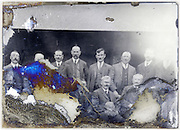 group of adult men portrait on a severely eroded glass plate