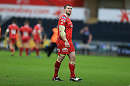 Morgan Allen of the Scarlets looks on. Guinness Pro12 rugby match, Ospreys v Scarlets at the Liberty Stadium in Swansea, South Wales on Saturday 26th March 2016.<br /> pic by  Andrew Orchard, Andrew Orchard sports photography.