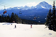 Skiing at Lake Louise ski resort, Banff National Park, Alberta, Rocky Mountains, Canada in 1981view to Mount Temple