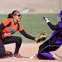041613       Cable Hoover<br /> <br /> Gallup Bengal shortstop Danitsa Zavala (2) reaches to stop the advance of Miyamura Patriot Baylee Schmaltz (9) at second base Tuesday at Gallup High School.