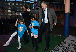 © Licensed to London News Pictures.14/01/2014. London, UK.London Mayor Boris Johnson and Richard Desmond, owner of The Health Lottery at the Glamis Adventure Playground during their visit the Shadwell Community Project in East London in celebration of The Health Lottery's pledge to raise £10 million for local London charities by 2016.Photo credit : Peter Kollanyi/LNP