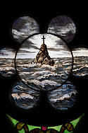 Painted stained glass depicts tempestuous waves and a rock with cross atop on Wednesday, Aug. 26, 2020, at St. Peter's Lutheran Church, LaGrange, Mo. LCMS Communications/Erik M. Lunsford