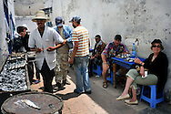 Morocco, Essaouira. One of the most popular restaurants serving grilled fish.