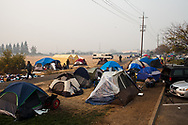 Tents are set up at a Walmart parking lot in Chico, California, by Butte County residents displaced by the Camp Fire, Friday, November 16, 2018. More than 50,000 people were evacuated from the Camp Fire according to Butte County officials, and many of them remain displaced weeks after the deadly wildfire swept through their homes.