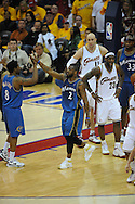 The Washington Wizards defeated the Cleveland Cavaliers 88-87 in Game 5 of the First Round of the NBA Playoffs, April 30, 2008 at Quicken Loans Arena in Cleveland.<br /> DeShawn Stevenson, 2, and Roger Mason high-five near Cleveland's LeBron James and Zydrunas Ilgauskas.