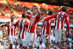 Stoke Forward Marko Arnautovic (AUT) gestures to the Aston Villa supporters after Defender Geoff Cameron (USA) scores a goal - Photo mandatory by-line: Rogan Thomson/JMP - 07966 386802 - 23/03/2014 - SPORT - FOOTBALL - Villa Park, Birmingham - Aston Villa v Stoke City - Barclays Premier League.