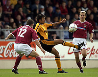 Photo: Richard Lane.<br />Northampton Town v Hull City. Nationwide Division Three. 04/10/2003.<br />Jason Price controls the ball as Chris Doig and Paul Trollope look on.