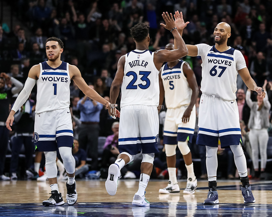 Feb 15, 2018; Minneapolis, MN, USA; Minnesota Timberwolves forward Taj Gibson (67) celebrates with guard Jimmy Butler (23) during the fourth quarter against the Los Angeles Lakers at Target Center. Mandatory Credit: Brace Hemmelgarn-USA TODAY Sports