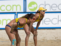 01-08-2014 AUT: FIVB Grandslam Volleybal, Klagenfurt<br /> Brasilian Players Juliana Felisberta Silva, Maria Elisa Antonelli at the women's Quaterfinal Match of the A1 Beachvolleyball Grand Slam <br /> ***NETHERLANDS ONLY***