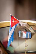 Close up Cuban flag in vintage car, Havana, Cuba