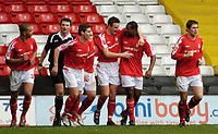 Photo: Leigh Quinnell.<br /> Nottingham Forest v Swindon Town. Coca Cola League 1. 25/02/2006. Ian Breckin(centre) celebrates his goal with hbis team mates.