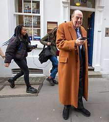 © Licensed to London News Pictures. 14/02/2020. London, UK. Former MP Sir Nicholas Soames gets caught up as students climate change strikers demonstrate on the streets of Westminster to protest against the Governments's lack of action on the climate crisis. Photo credit: Alex Lentati/LNP