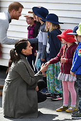The Duke and Duchess of Sussex speaks with children during their meeting with young people in the mental health sector, at the Wellington Cafe, Wellington, New Zealand. PRESS ASSOCIATION Photo. PRESS ASSOCIATION Photo. Picture date: Sunday October 28, 2018. See PA story ROYAL Tour. Photo credit should read: Dominic Lipinski/PA Wire