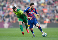 Leo Messi of FC Barcelona challenges Cote of SD Eibar (left) during the twenty five round match of the La Liga 2019-2020 season between FC BARCELONA and SD EIBAR at CAMP NOU  STADIUM in Barcelona, Spain. February 22,2020