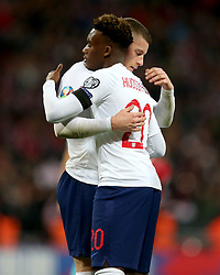 England's Ross Barkley (left) and Callum Hudson-Odoi celebrate Czech Republic's Tomas Kalas (not pictured) scoring an own goal during the UEFA Euro 2020 Qualifying, Group A match at Wembley Stadium, London.