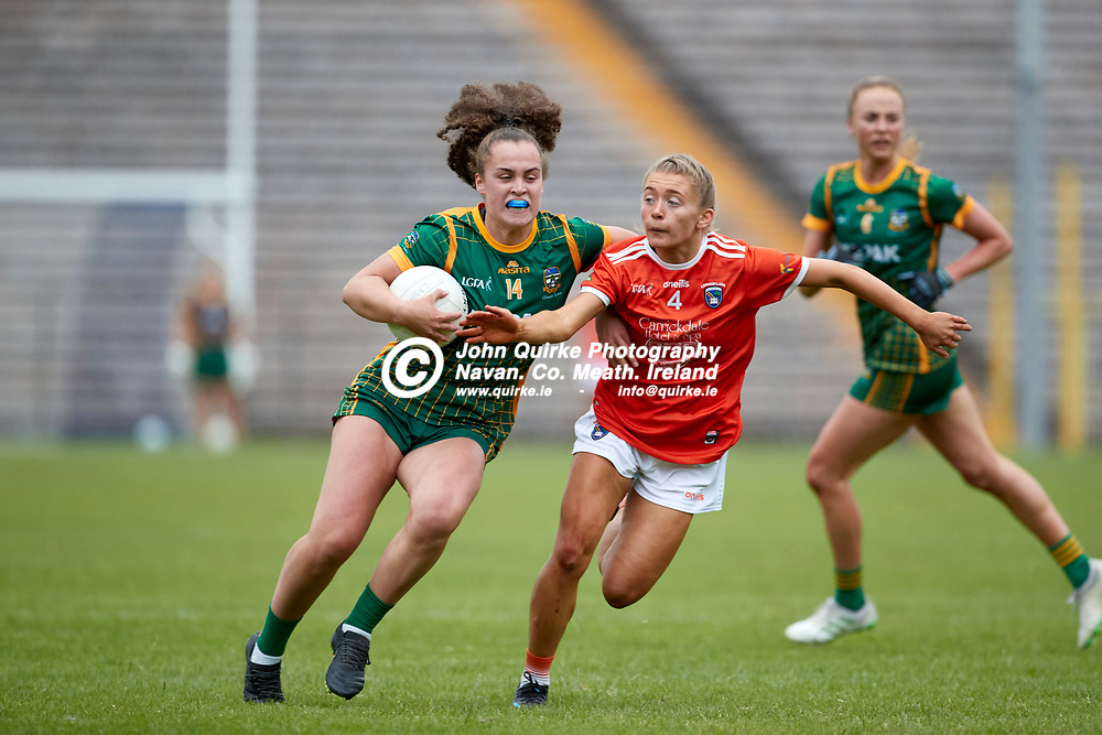 01-08-21, All Ireland Ladies SFC quarterfinal at Clones<br /> Meath v Armagh<br /> Emma Duggan (Meath) and Grace Ferguson (Armagh)<br /> Photo: David Mullen / www.quirke.ie ©John Quirke Photography, Proudstown Road Navan. Co. Meath. 046-9079044 / 087-2579454.<br /> ISO: 400; Shutter: 1/1250; Aperture: 4.5;