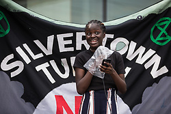 London, UK. 5th June, 2021. Destiny Boka Batesa of Choked Up addresses environmental activists and local residents protesting against the construction of the Silvertown Tunnel. Campaigners opposed to the controversial new £2bn road link across the River Thames from the Tidal Basin Roundabout in Silvertown to Greenwich Peninsula argue that it is incompatible with the UK's climate change commitments because it will attract more traffic and so also increased congestion and air pollution to London's most polluted borough.
