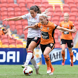 BRISBANE, AUSTRALIA - JANUARY 7: Amy Chapman of the Roar and Paige Nielsen of the Wanderers compete for the ball during the round 11 Westfield W-League match between the Brisbane Roar and Western Sydney Wanderers at Suncorp Stadium on January 7, 2017 in Brisbane, Australia. (Photo by Patrick Kearney/Brisbane Roar)