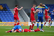 AFC Wimbledon striker Ollie Palmer (9) laying on top of Crawley Town defender Jordan Tunnicliffe (19) after diving header during the The FA Cup match between AFC Wimbledon and Crawley Town at Plough Lane, London, United Kingdom on 29 November 2020.