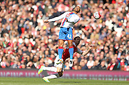 Jason Puncheon of Crystal Palace jumps to head the ball over Nacho Monreal of Arsenal. Barclays Premier league match, Arsenal v Crystal Palace at the Emirates Stadium in London on Sunday 17th April 2016.<br /> pic by John Patrick Fletcher, Andrew Orchard sports photography.